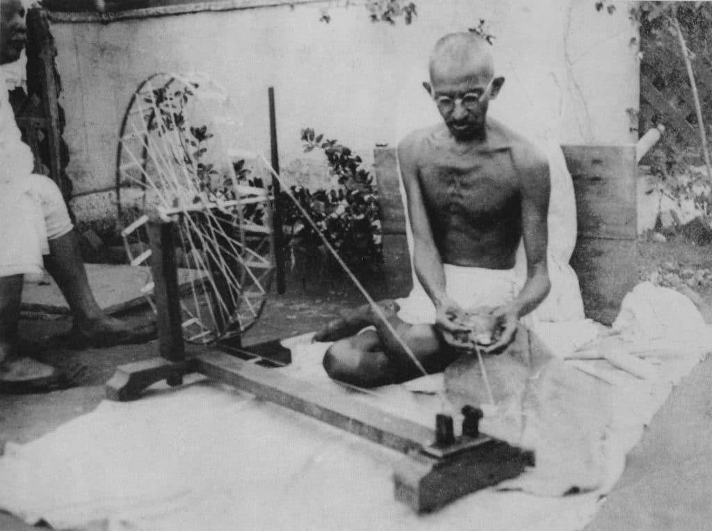Gandhi spinning. Location unknown, late 1940s Photo: Unknown/gandhiserve.org. Public Domain.