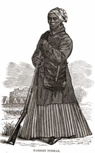 A woodcut image of Harriet Tubman, made prior to book publication date of 1869: Scenes in the Life of Harriet Tubman by Sarah H Bradford Author woodcut artist not listed; W.J. Moses, printer; stereotyped by Dennis Bro's & Co. Public Domain.