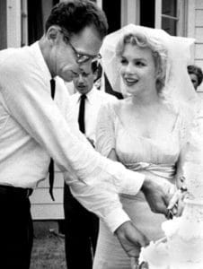 """Marilyn Monroe and Arthur Miller at their wedding from the May 1961 issue of TV-Radio Mirror. Photo: Macfadden Publications New York, publisher of Radio-TV Mirror. Public Domain. Source: <a href=""""https://commons.wikimedia.org/wiki/File:Monroe_Miller_Wedding.jpg"""">Wikimedia Commons</a>."""