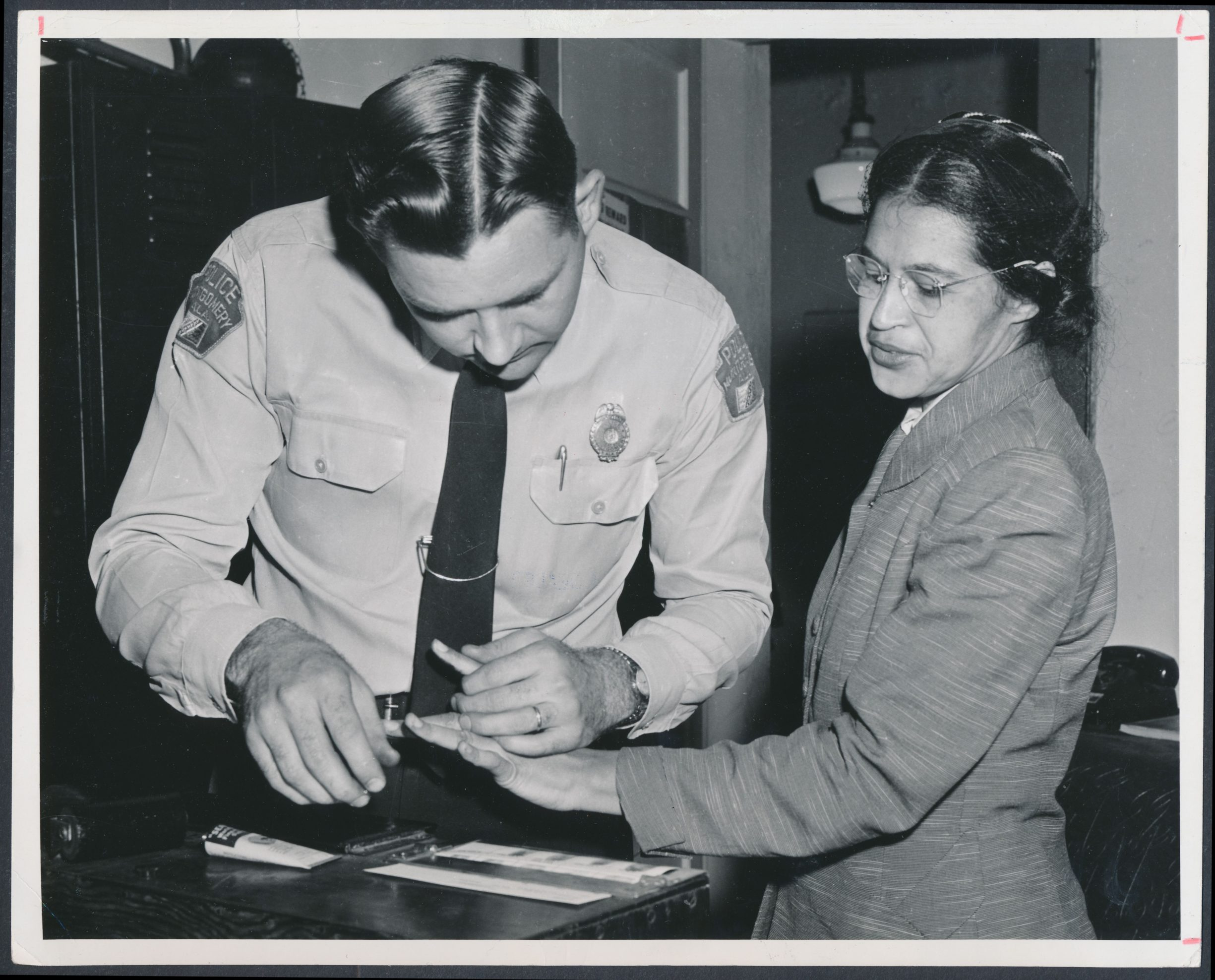 Rosa Parks being fingerprinted on February 22, 1956, by Deputy Sheriff D.H. Lackey as one of the people indicted as leaders of the Montgomery bus boycott. She was one of 73 people rounded up by deputies that day after a grand jury charged 113 African Americans for organizing the boycott. This was a few months after her arrest on December 1, 1955, for refusing to give up her seat to a white passenger on a segregated municipal bus in Montgomery, Alabama. Photo: Associated Press. Public domain.