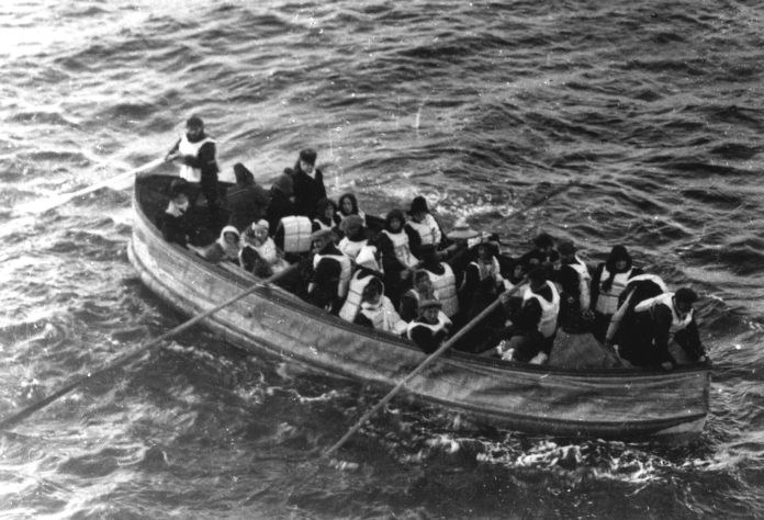 Titanic. Last lifeboat arrived, filled with Titanic survivors. This photograph was taken by a passenger of the Carpathia, the ship that received the Titanic's distress signal and came to rescue the survivors. It shows the last lifeboat successfully launched from the Titanic. Date: 15 April 1912 (original photo taken). Photo: passenger on the Carpathia. Public Domain.