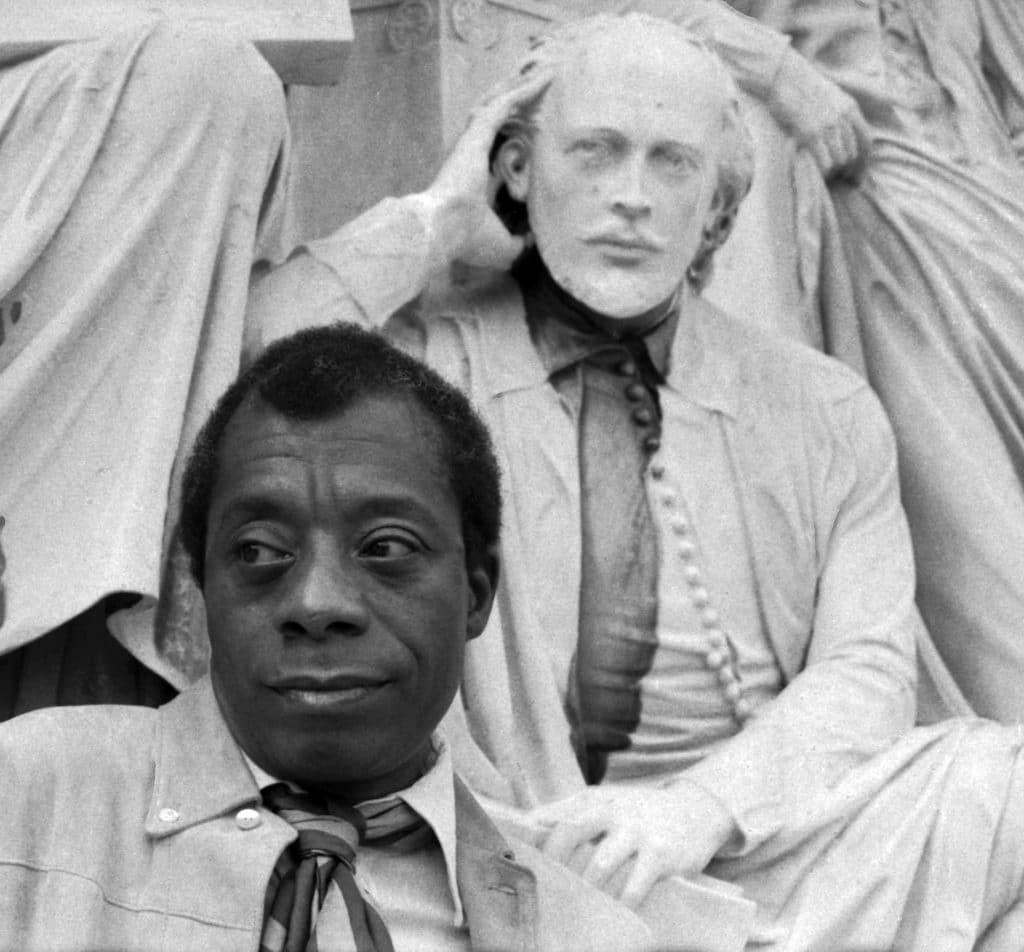 Portrait of James Baldwin with the statue of Shakespeare Albert Memorial, 1969. Photo: Allan warren. (CC BY-SA 3.0)