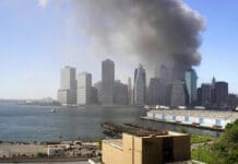 This is a panorama stitched together from 4 photos taken on the morning of September 11, 2001 from the Brooklyn Promenade. Photo: Jeffrey Bary. (CC BY 2.0).