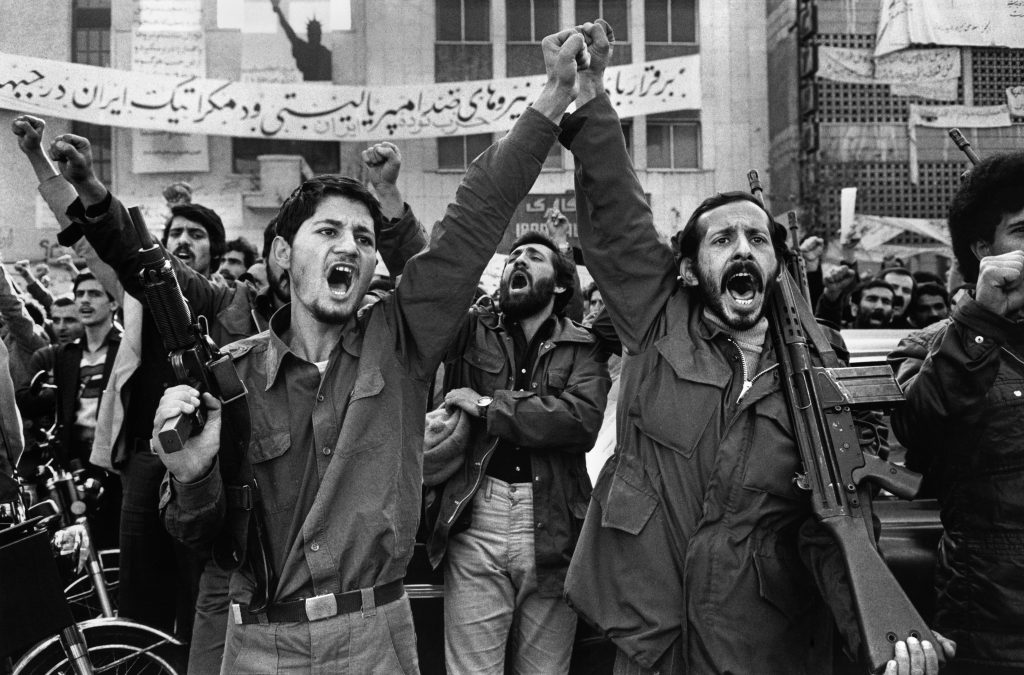 """Revolutionaries during the Iranian revolution, 1979. Photo: Unknown. Public Domain. Source: <a href=""""https://commons.wikimedia.org/wiki/File:Enghlab_Iran.jpg"""">Wikimedia Commons</a>"""