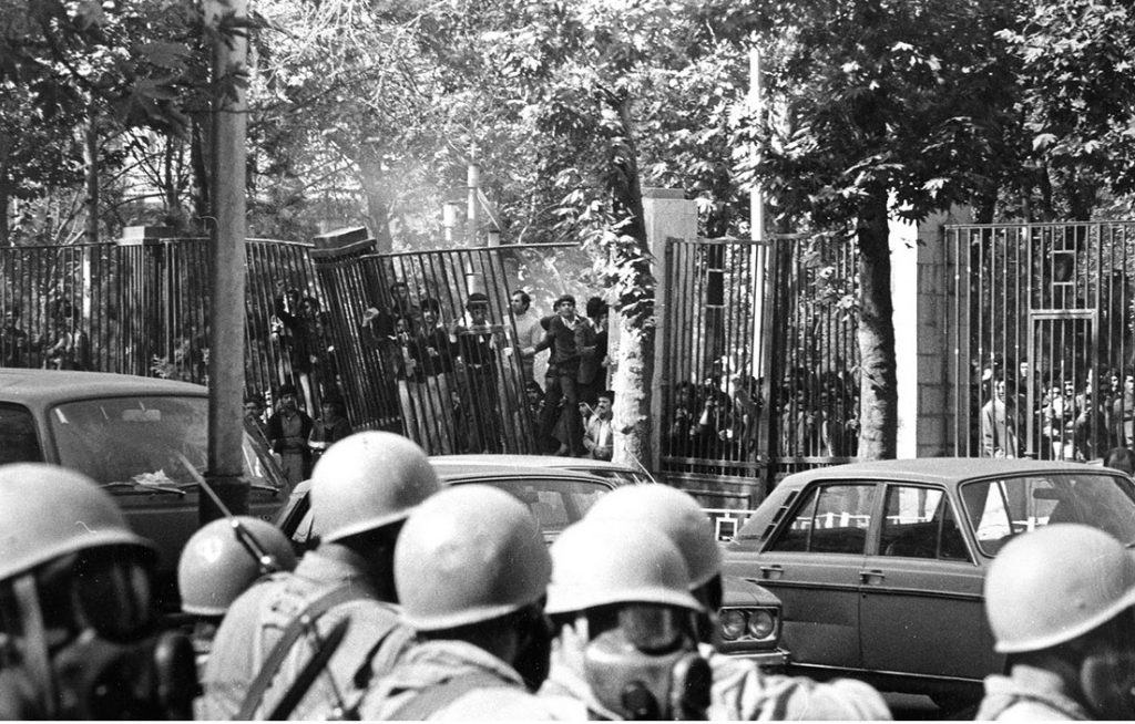 """Students and the Army, University of Tehran - 4 November 1978. Author: iichs.ir (unknown photographer). Public Domain. Source: <a href=""""https://commons.wikimedia.org/wiki/File:Students_and_the_Army,_University_of_Tehran_-_4_November_1978.jpg"""">Wikimedia Commons</a>"""