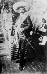 Emiliano Zapata. Source : http://memory.loc.gov/service/pnp/ggbain/14900/14906v.jpg Author: Bain News Service, publisher. Public Domain (Library of Congress, Prints & Photographs Division, [reproduction number, e.g., LC-B2-1234]) No known restrictions on publication.