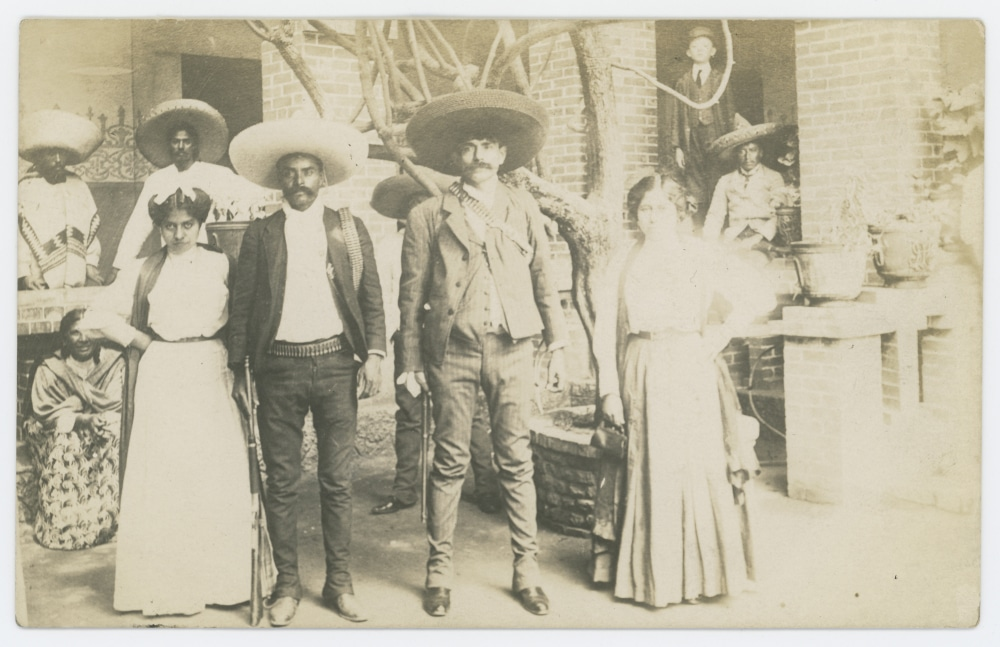 Emiliano Zapata, Brother Eufemio, with Wives. Creator: Brehme, Hugo. Date: 1 January 1914 Part of: http://digitalcollections.smu.edu/cdm/search/collection/pwl/searchterm/Elmer and Diane Powell collection on Mexico and the Mexican Revolution/mode/exact Place: Mexico. Source: https://www.flickr.com/photos/smu_cul_digitalcollections/30138746320/ Author: SMU Central University Libraries. No known copyright restrictions.