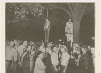 """Schomburg Center for Research in Black Culture, Photographs and Prints Division, The New York Public Library. """"View of the lynching of Tom Shipp and Abe Smith at Marion, Indiana, August 7, 1930."""" Photo: Lawrence Beitler (1885–1960) Photographer) ©. Collection: The New York Public Library Digital Collections. 1930."""