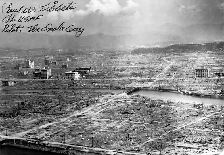 """Destructed Hiroshima with autograph of """"Enola Gay"""" Bomber pilot Paul Tibbets. Photo: US Navy. Post-Work: User:W.wolny. Public Domain."""