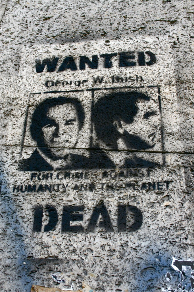 """""""George Walker Bush - For crimes against humanity and the planet - Wanted Dead"""". Photo from mural taken November 2007 by tristanski. (CC BY 2.0)."""