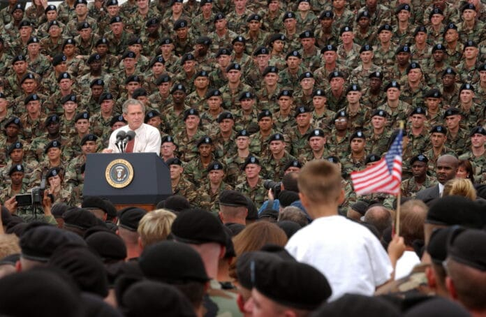 President George W. Bush addresses troops and families of the 10th Mountain Division and other members of the Fort Drum Community at Fort Drum, N.Y., July 19, 2002. Series: Photographs Related to the George W. Bush Administration, 1/20/2001 - 1/20/2009 Collection: Records of the White House Photo Office (George W. Bush Administration), 1/20/2001 - 1/20/2009. Public Domain.