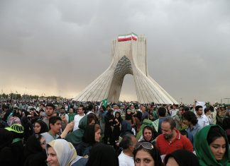 Thousands of supporters of presidential candidate of Iran, Mir Hossein Musavi gathered together in Tehran,Azadi square showing their support. Source: دوربین شخصی Author: ? Public domain. Source: Wikimedia Commons