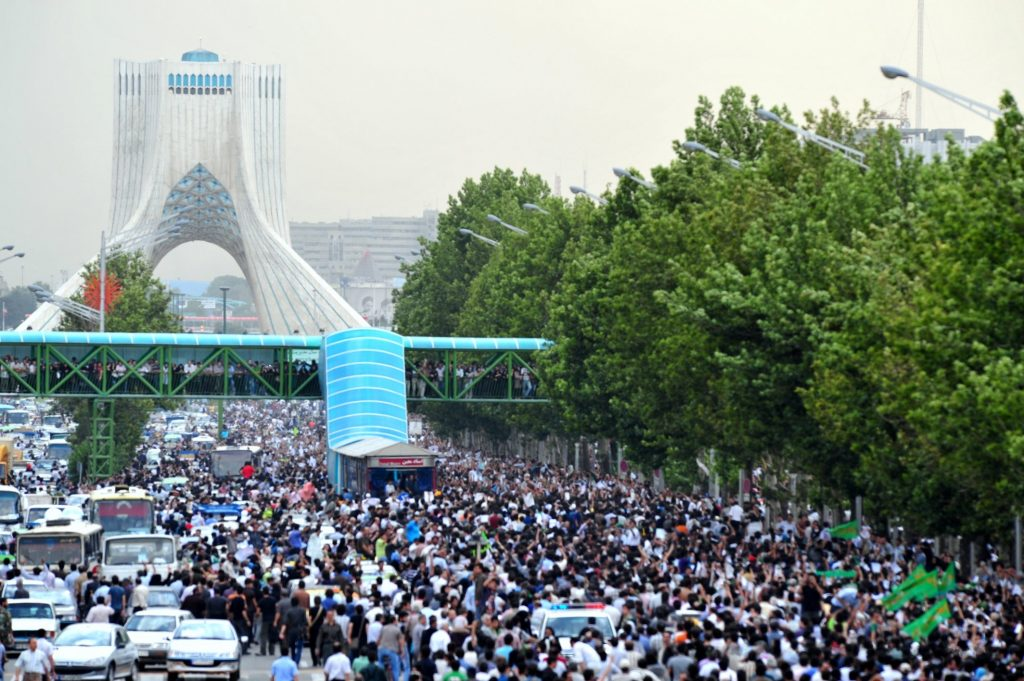 """3rd Day - The Green Protest Rally. 15 June 2009. Author: Hamed Saber. (CC BY 2.0). Source: <a href=""""https://commons.wikimedia.org/wiki/File:3rd_Day_-_The_Green_Protest_Rally.jpg"""">Wikimedia Commons</a>"""