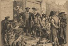 Usigneret, men tilskrevet Louis Moe (1857–1945) baseret på et maleri af Carl Bloch (1834–1890). Danmarks historie i Billeder XXXIII, Hans Tavsen forsvarer Joakim Rönnov. I 1533 blev reformatoren Hans Tausen dømt for blasfemi og det ophidsede de protestantiske borgere i København. Litografiet viser, hvordan Tausen forsvarer biskop Joachim Rønnow mod folkemængden. Farvelitografi på papir, opklæbet på pap. Alfred Jacobsens litogr. Etablissement, København K. Samlingen omfatter 50 billeder, mus.nr. 17.001-17.049. Nr. VI og L mangler. Samlingen er udgivet i 1898, se V.E. Clausen: Folkelig grafik i Skandinavien, 1973 s. 144. 70.9 Cl f. Udstillet i juli-august 1906 iflg. årsberetning 1906-07. 1 dublet. 1898. Anskuelsestavle på papir med litografi, svagt gulligt. Nuværende placering: AU Library, Campus Emdrup. Credit: Fra Dansk Skolemuseum. (CC BY-SA 4.0).