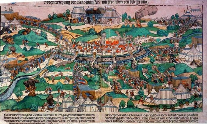 The city of Münster under siege by prince bishop Franz von Waldeck in 1534. The picture shows the first attack at Pentecost. The text below the image says:
