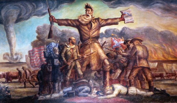Tragic Prelude. A mural in the Kansas State Capitol. He carries in one hand a Bible and in the other a Beecher's Bible (rifle). Union and Confederate forces are fighting, with casualties. A tornado approaches in the background, as does a prairie fire, both common in Kansas. Oil and tempera painted in 1938 by John Steuart Curry (1897–1946), American painter and printmaker. Collection: Kansas State Capitol, USA. Public Domain.