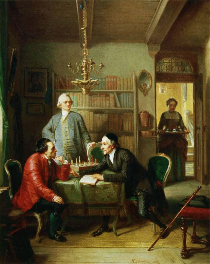 """Lavater and Lessing Visit Moses Mendelssohn. Portrays an imagined meeting among Mendelsohn (1729-1786) and Gotthold Ephraim Lessing (1729-1781), and the Swiss theologian Johann Kaspar Lavater (1741-1801), at the residence of Moses Mendelssohn located at Spandauerstraße 68, Alt Berlin. Mendelssohn (on the left), wearing a red coat, and seated at a chess table in his library with Lavater. Lessing stands at the center behind the two. The scene refers to two foundational moments in the history of German-Jewish cultural interaction. The actual meetings between Mendelssohn and Lavater, which took place in 1763-64, were followed by the failed attempt on the part of the theologian to convince Mendelssohn to embrace Christianity. The well-known friendship between Mendelssohn and Lessing, one of the high points of the haskalah, or """"Jewish Enlightenment,"""" came to be considered a paradigm of the possibility of a harmonious cohabitation between Germans and Jews. Painted in 1856 by Moritz Daniel Oppenheim (1800–1882), German painter. Collection: Judah L. Magnes Museum / The Magnes Collection of Jewish Art and Life, Californien. (CC BY-NC-SA 3.0)."""