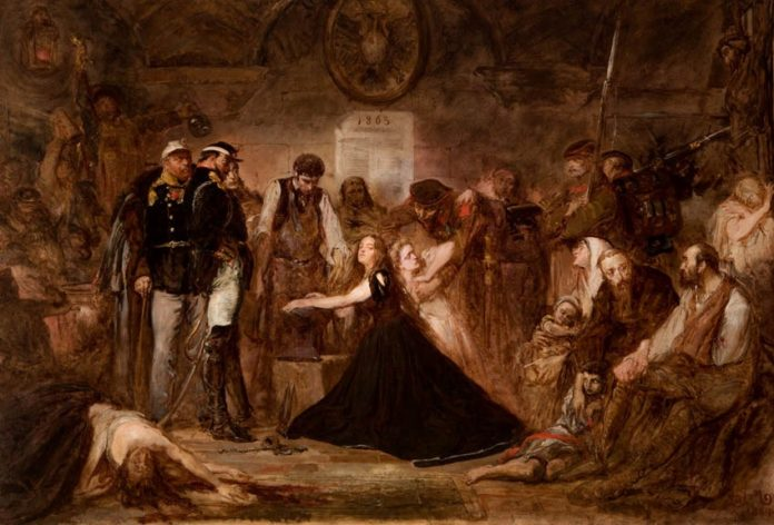Zakuwana Polska (Polonia, Rok 1863). Oilpainting on canvas by Jan Matejko (1838-1893). Collection Czartoryski Museum. The aftermath of the failure of the January Uprising. The crowd of captives awaits transport to Siberia. Russian officers and soldiers supervise a blacksmith installing fetters on the wrists of a woman representing Poland. The blonde woman behind her, next in line, may represent Lithuania. Photographer: mnk.pl Public Domain.