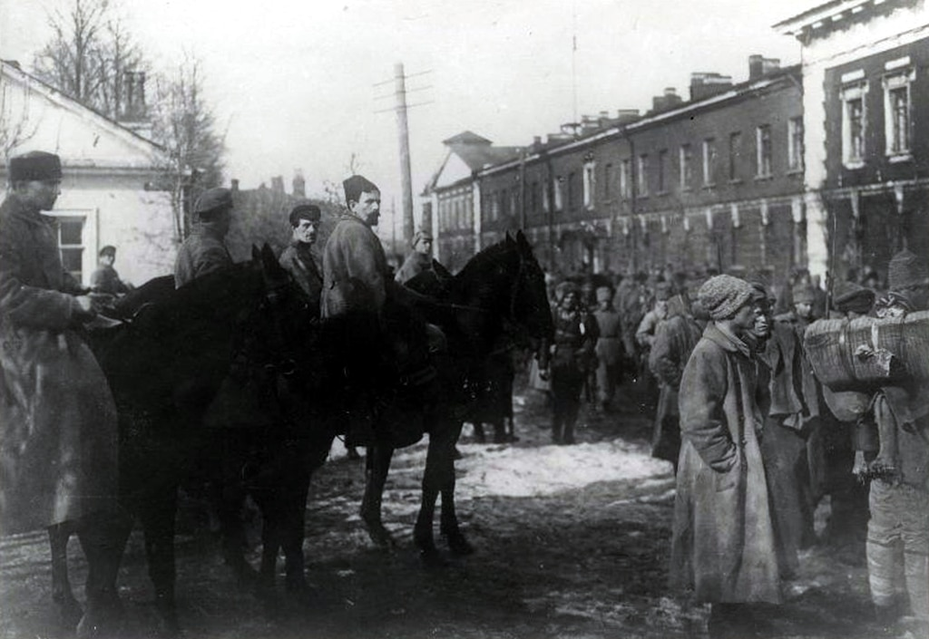 Red Army troops enter Kronstadt after the liquidation of the Kronstadt Kronstadt rebellion. Left: Ivan Fedko. Center: Pavel Dybenko. 18 March 1921. Photo: Unknown. Public Domain.