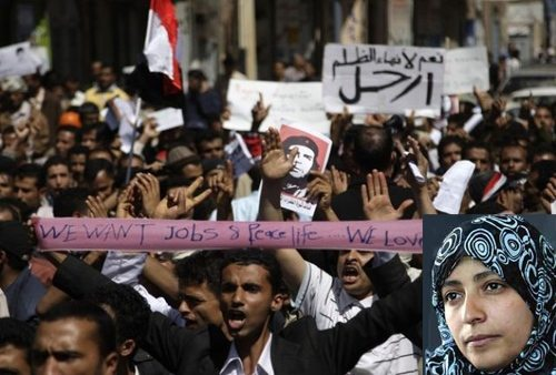 """Picture from demonstration in Yemen 2011. Sign in right background above reads """"Yes for Ending Oppression! (Arhal!) Leave!"""". Inset on lower right above is Tawakul Karman, director of Women Journalists Without Chains, who was arrested by al-mukhabarat police, and held for 30 hours on January 23-24). Photo: Masdar Online (Here from: Yemen's Popular Uprising in Photos, by Stephen Day"""