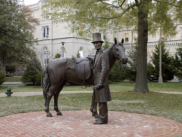 Bronze statue of Abraham Lincoln and his horse at the Lincoln Summer Home located on the grounds of the Armed Forces Retirement Home in northwest Washington, D.C. The sculptors are Stuart Williamson and Jiwoong Cheh; working for the design shop StudioIES in Brooklyn; New York. The statue differs from so many others of Abe in that this one actually shows him with a slight smile; as if Lincoln is greeting a valued friend or relative upon arrival at his summer home. Photo: Taken 24 November 2008 by Carol M. Highsmith (1946–). Public Domain. Collection: Library of Congress Prints and Photographs Division Washington, D.C.