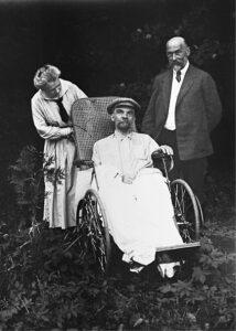 One of the last photographs of Lenin. Taken in Gorki after May 15th 1923. Beside him are his sister Anna Ilyinichna Yelizarova-Ulyanova and one of his doctors A. M. Kozhevnikov. Photo: Maria Ulyanova. Public Domain.