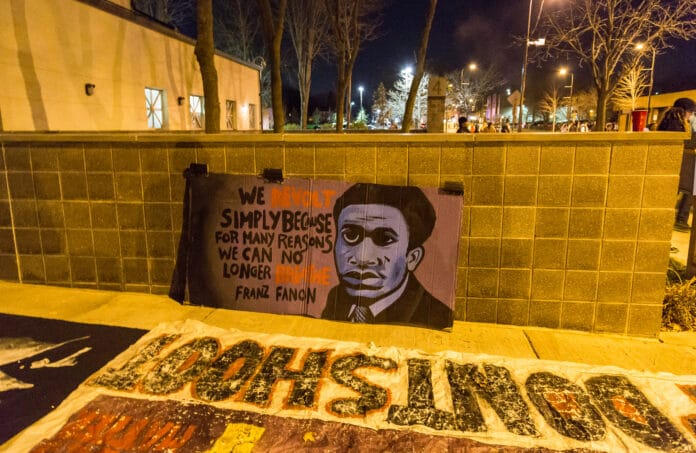 Banner outside the Minneapolis Police Department fourth precinct, Plymouth Avenue, following the officer-involved shooting of Jamar Clark on November 15, 2015. The quote says:
