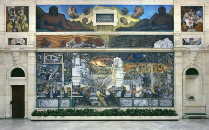 In 1932, Diego Rivera was commissioned to paint twenty-seven frescoes in the Detroit Institute of Art in Midtown Detroit, Michigan, U.S. From the 27 murals that Rivera painted, the two largest murals are located on the north and south walls. They depict laborers working at Ford Motor Company's River Rouge Plant. Overview of Detroit Industry, North Wall, 1932-33, fresco by Diego Rivera. Collection: Detroit Institute of Arts. Public Domain.