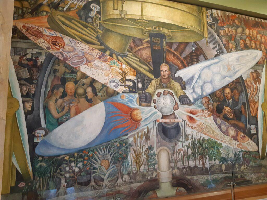 """""""El hombre controlador del universo"""" , or also known as """"El hombre en el cruce de caminos"""" a fresco painting with dimensions of 4.80 × 11.45 m, made by Diego Rivera. This painting is located in the Palacio de Bellas Artes, in CDMX. Photo: Taken 6 July 2019 by Renata Frias. (CC BY-SA 4.0)."""