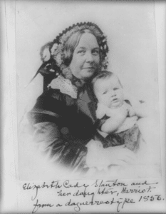 Elizabeth Cady Stanton holding her daughter Harriot, half-length portrait, facing right. (cropped). Between 1890 and 1910 of daguerreotype taken 1856. Photo: Unknown. Public Domain.