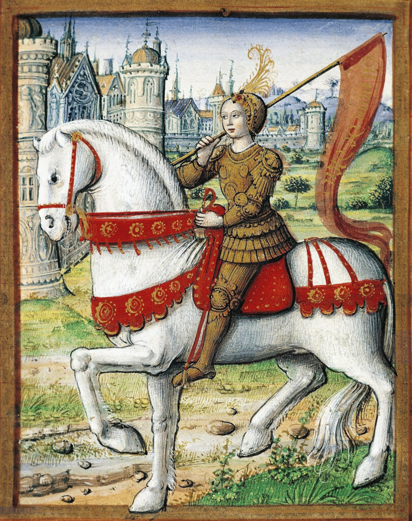 Joan of Arc depicted on horseback in an illustration from a 1504 manuscript. Miniature adorning The Lives of Famous Women by Antoine Dufour 1504-1506. Illumination on vellum painted by Jean Pichore (worked from 1502-1521), French manuscript illuminator. Collection: Musée Dobrée, Nantes, France. Public Domain.
