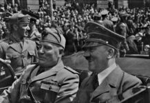 Hitler_and_Mussolini_in_Munich,_Hitler and Mussolini in Munich, Germany, circa June 1940. Eva Braun's Photo Albums, ca. 1913-ca. 1944. General Services Administration, U.S. National Archives and Records Service. Office of the National Archives, ca. 1949-1985. Record Group 242: National Archives Collection of Foreign Records Seized, 1675-1958. Public Domain.