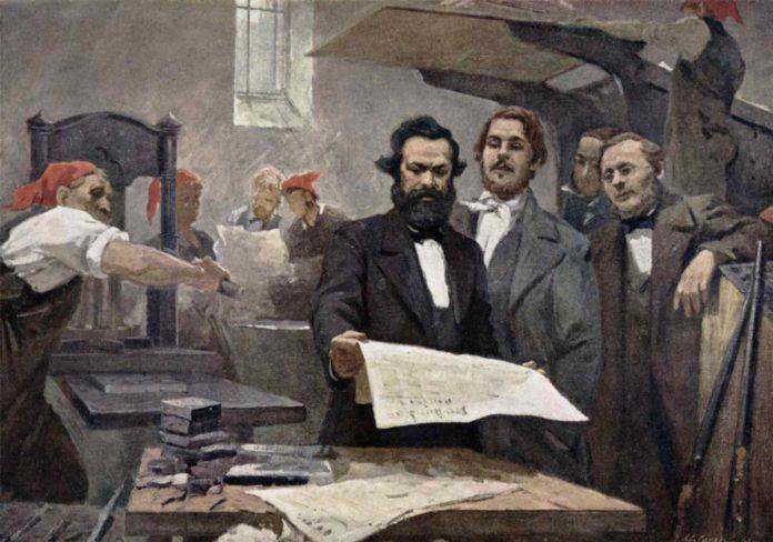 Marx & Engels blev på Komunisternes Forbunds kongres i London pålagt at formulere et programskrift, Det Kommunistiske Manifest. Her er de 2 malet i Rheinische Zeitung's trykkeri, ca. 1849. Oliemaleri på lærred af E. Capiro. Public Domain. Se nedenfor 1. juni 1847.