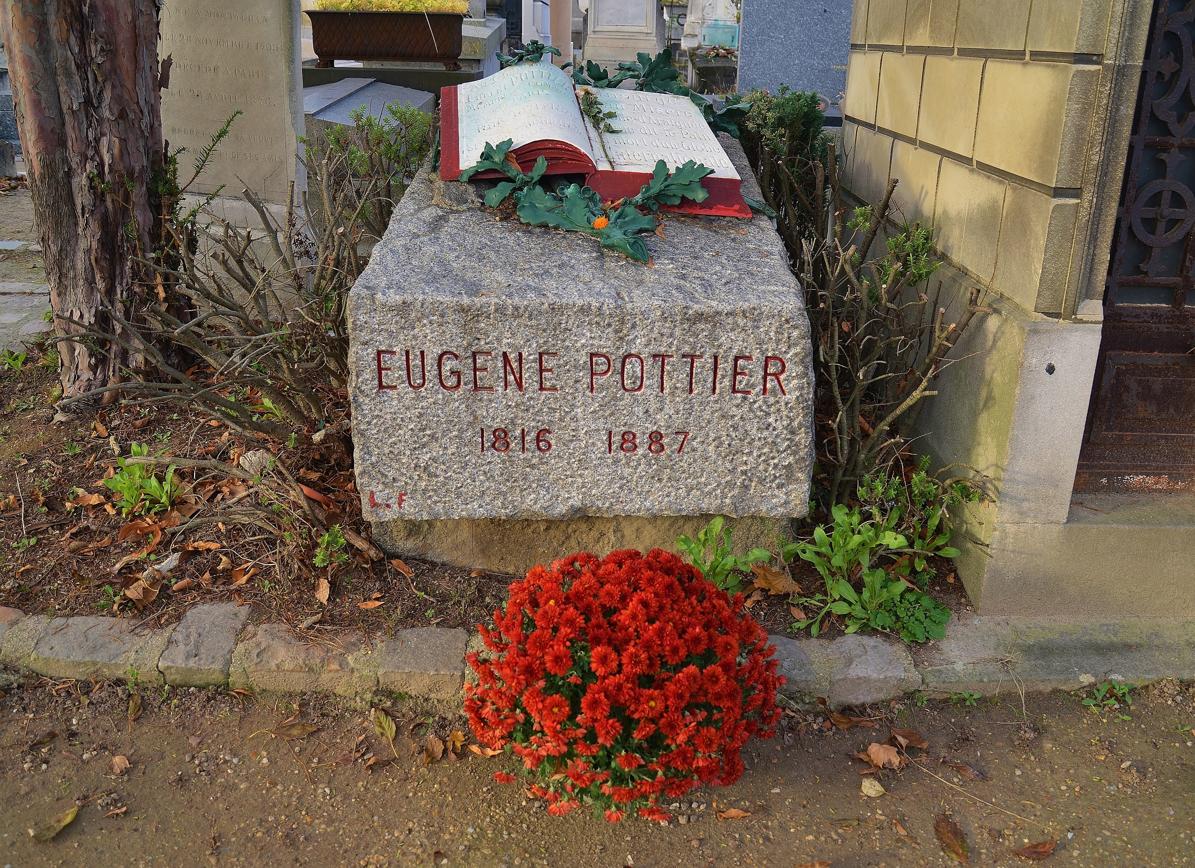 The Tomb of Eugene Pottier (1816-1887), who wrote L'Internationale in 1871. Pere Lachaise Cemetery, Paris, France. Taken on November 5, 2015 by Barry Marsh. Public Domain.