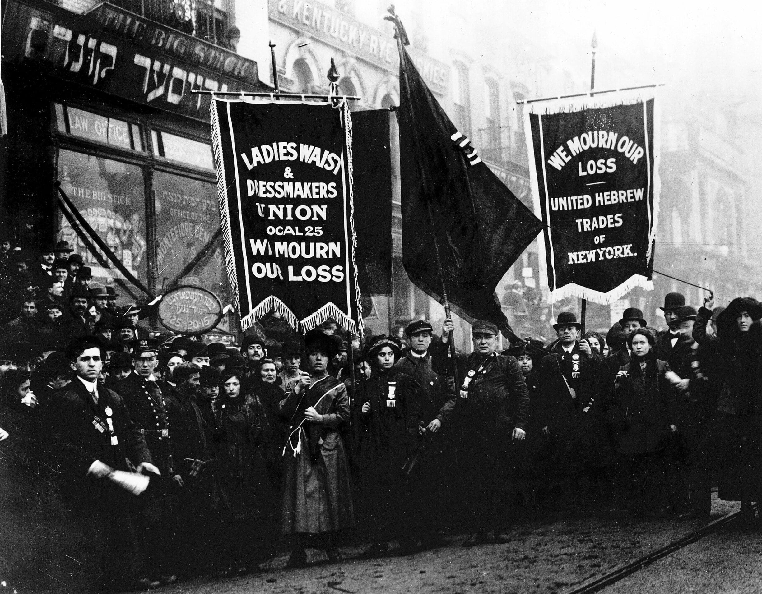 Mourners from the Ladies Waist and Dressmakers Union Local 25 and the United Hebrew Trades of New York march in the streets after the Triangle fire in 1911. Photo: Unknown. Collection: International Ladies Garment Workers Union Photographs (1885-1985) Repository: The Kheel Center for Labor-Management Documentation and Archives. (CC BY 2.0).