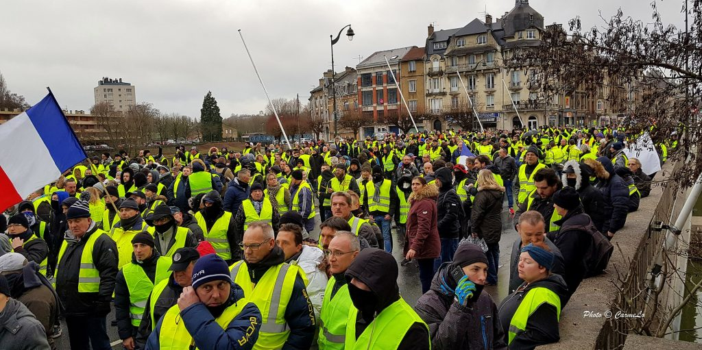 """Mouvement gilets jaunes - Acte 8 - Charleville -Mézières 08000 Ardennes - France. Date: 5 January 2019. Author: Carmelo DG from Verneuil Grand, France. (CC BY 2.0) Source: <a href=""""https://commons.wikimedia.org/wiki/File:GJ_20190105_151557_(46642348481).jpg"""">Wikimedia Commons</a>"""