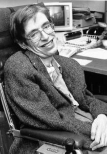 """NASA StarChild image of Stephen Hawking, the cosmologist and divulging scientist, who was elected a member of the Royal Society in 1974. Date: Unknown date (photograph). 1999-01-03 (file's timestamp at starchild.gsfc.nasa.gov). Source: (StarChild Learning Center). Directory listing. Author: NASA. Public Domain Source: <a href=""""https://commons.wikimedia.org/wiki/File:Stephen_Hawking.StarChild.jpg"""">Wikimedia Commons</a>"""