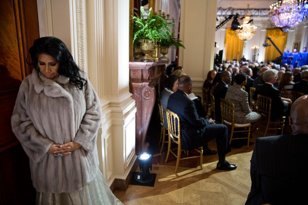 """Aretha Franklin prepares to perform during """"The Gospel Tradition: In Performance at the White House"""" in the East Room of the White House, April 14, 2015. (Official White House Photo by Pete Souza). Author: The White House from Washington, DC. Public Domain. Source: Wikimedia Commons"""