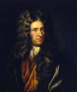 Daniel Defoe (1611-1731), a half-length portrait to right in blue and orange gown and brown full bottomed wig. Oil on canvas painting from 17th-18th century in the style of Sir Godfrey Kneller (1646-1723) German portraet painter in England. Collection: Royal Museums Greenwich, England. Public Domain.