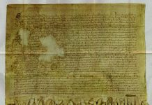 "Reproduction of the ""Tyninghame"" (1320 A.D) copy of the Declaration of Arbroath. 1320 (manuscript): Author: Scotland barons. Public Domain."