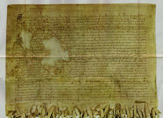 """Reproduction of the """"Tyninghame"""" (1320 A.D) copy of the Declaration of Arbroath. 1320 (manuscript): Author: Scotland barons. Public Domain."""